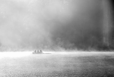 pang: Rowboat on the lake at morning fog at Mae Hong Son or Pang Ung. black and white picture Stock Photo
