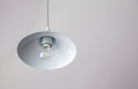 wall light: Warm lighting coming out from beautiful lamps on ceiling. Electric lamp in dark in a cafe.