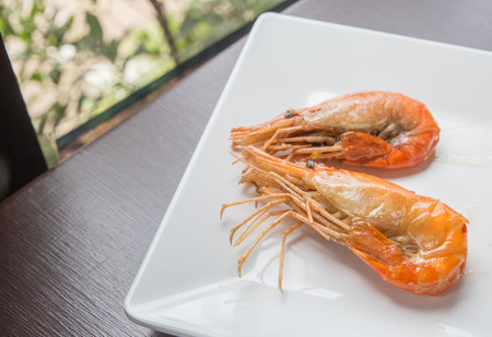 background textures: Two shrimp in white plate Stock Photo