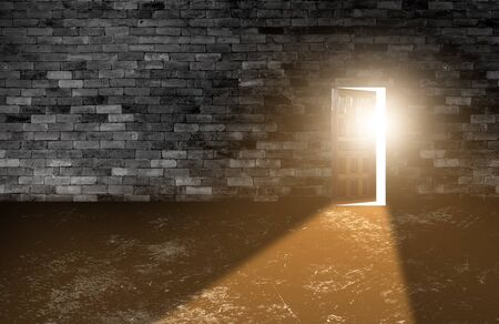 Wood doors opening with old cement wall and light coming in. background of old vintage white brick. Imagens