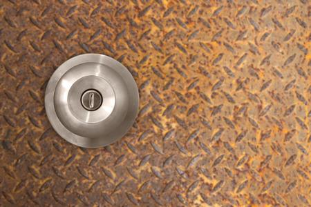 Double plug socket on the wall on metal iron rust background Stock Photo