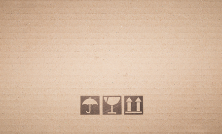 shipped: Symbol box Paper texture brown sheet background.