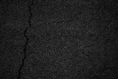 Asphalt background texture with some fine grain with crack road 스톡 콘텐츠