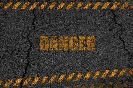 Asphalt background texture danger with some fine grain with crack road Stock Photo