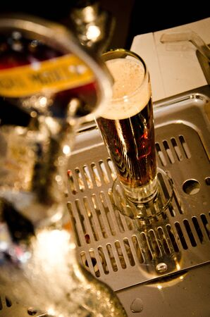 Glass of draft beer in a bar Imagens