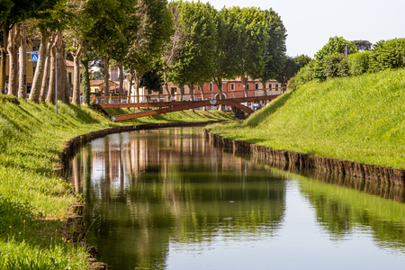 Water canal under the walls of the city of Cittadella, Padua province, Italy