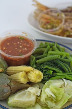 Chilli sauce, fried mackerel, boiled vegetable and rice from the market in Bangkok. photo