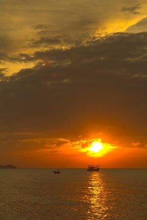 Sunset at the beach in Thailand photo