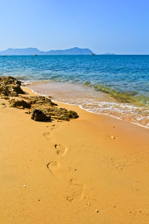 Footprint at the beach photo