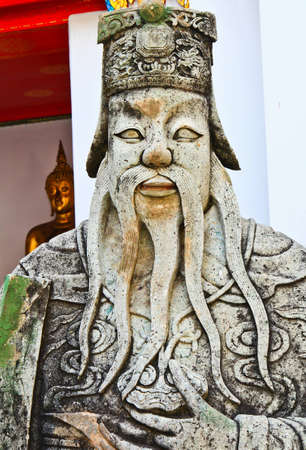 Statue at Wat Arun Rajwararam in Thailand photo