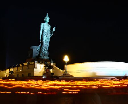 Candle lit buddha Makha Bucha in thailand photo