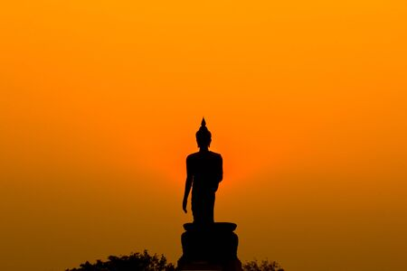 buddha  sunset in thailand photo