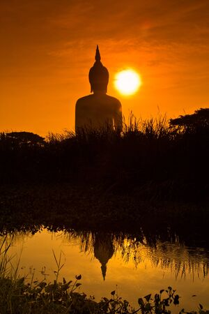 Big buddha sunset statue at Wat muang, Thailand  photo