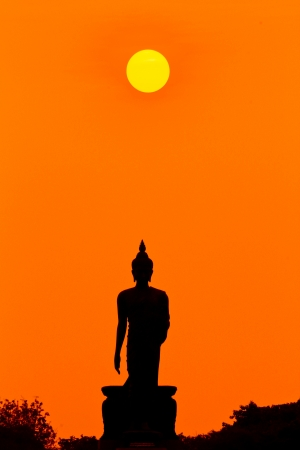 tranquil atmosphere: buddha  sunset in thailand