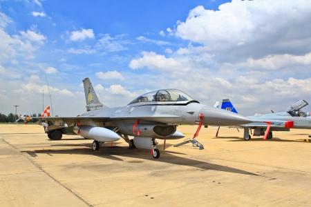 f 16: BANGKOK, THAILAND - JULY 02  F-16 was shown at Cerebration of 100 year of Royal Thai air force  RTAF  at Don Muang airport on July 02,2012 in Bangkok, Thailand