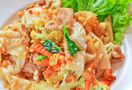 Stir fried noodles with egg, pork, green vetgetables, and sweet  photo