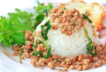 Thai food Thai spicy food, Fried pork with sweet basil whit basi  photo