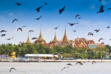 BANGKOK,THAILAND-NO VEMBER 9 Decorated barge parades past the Grand Palace at the Chao Phraya River during Fry the Kathina ceremony cloth of Royal Barge Procession on Nov  9, 2012 in Bangkok,Thailand  Stock Photo - 16943975