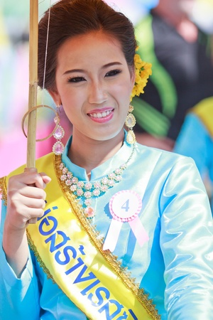 CHIANG MAI, THAILAND-JANUARY 19   30th anniversary Bosang umbrella festival,Woman in traditional costume during the annual Umbrella festival at San Kamphaeng  on Jan 19, 2013 in Chiang Mai, Thailand   Stock Photo - 18401346