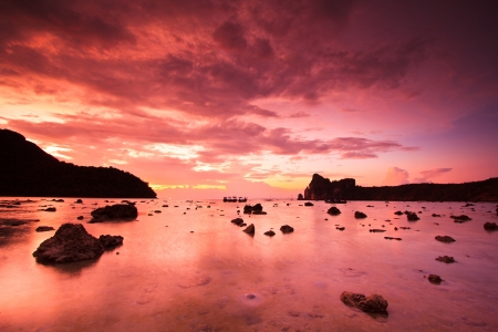 Sea stones at sunset Phi Phi Island thailand photo