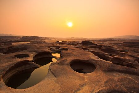 sunset rock holes  stone View Sam-Pan-Bok Grand Canyon in thailand  photo