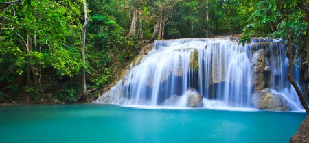 Waterfall in the forest asia thailand photo