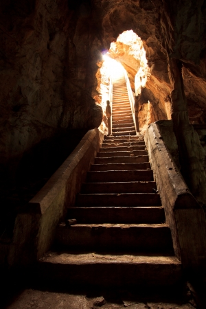 Exit of a cave ancient in thailand  photo