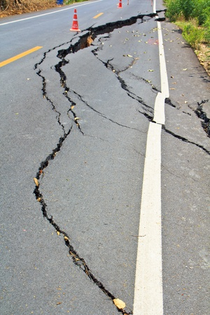 Cracked surface of an asphalt road  photo