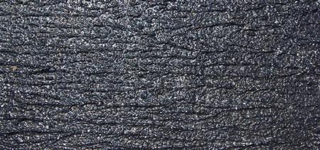 dark asphalted surface background photo