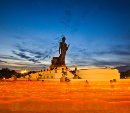 lent: Buddha statue candle lit in lent day thailand and Walk with lighted candles in hand around a temple
