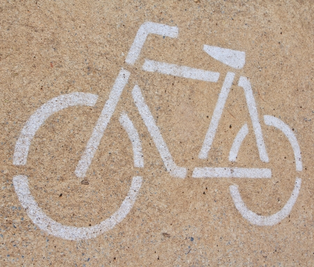 A sign of bicycle path and Parking photo