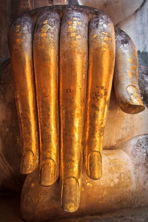 Buddha Old hand in Sukhothai Historic Park,Thailand photo