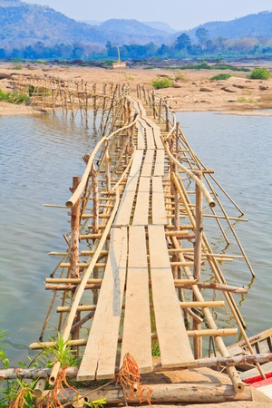 long tailed boat: Bamboo bridge across the river  Mekong River  thailand  Stock Photo