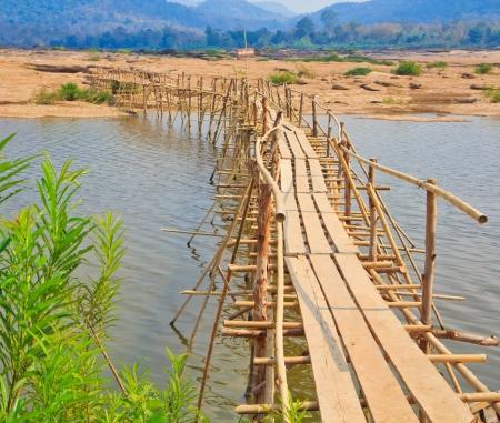 elevated walkway: Bamboo bridge across the river  Mekong River  thailand  Stock Photo