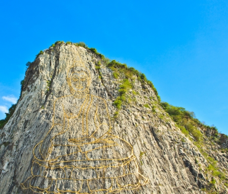 Carved buddha image on the cliff at Khao Chee Jan, Pattaya, Thailand  photo