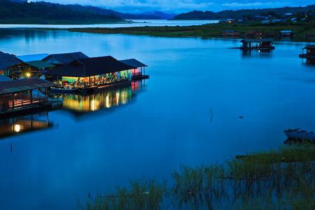 Morning light at Waterfront home and Home in the water and raft in Sangklaburi kanchanaburi Province Asai Thailand Stock Photo - 22291495