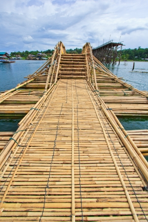 Bamboo bridge across the river in Sangkhlaburi kanchanaburi Province Asia Thailand  photo
