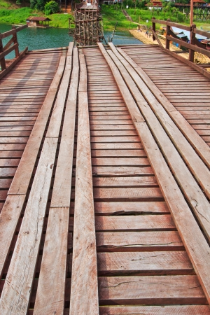The old wooden bridge Bridge collapse Bridge across the river and Wood bridge  Mon bridge  at sangklaburi, kanchanaburi, Province Asia thailand photo