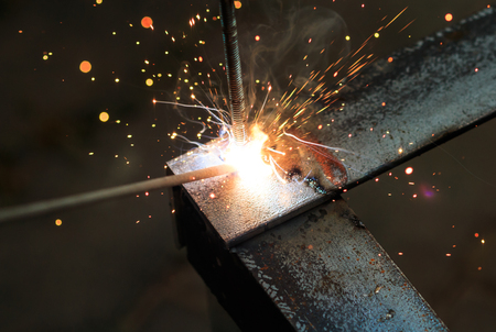 worker with welding metal and sparks welding with sparks  photo