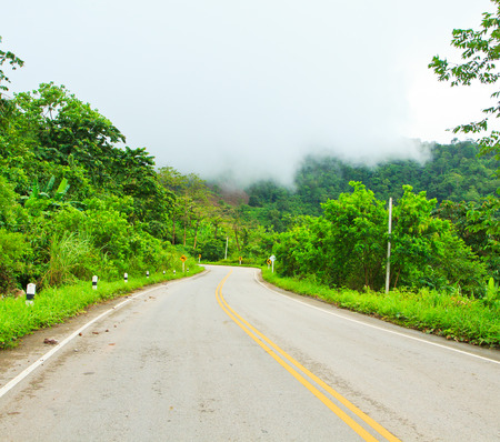 Winding Paved Road in the Phetchabun Province asai Thailand  photo