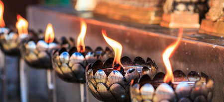 blue flame: Oil lamp arranged in patterns Beautiful  Stock Photo