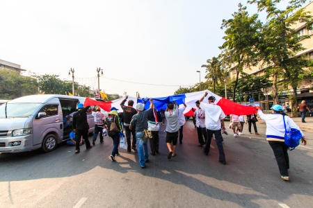 protestors: BANGKOK, THAILAND-DECEMBER 9   The big group of protestors to at Democracy monument on Ratchadumnoen road in Bangkok on December 9, 2013 in Bangkok, Thailand