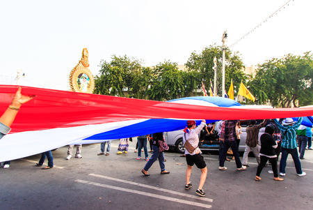 BANGKOK, THAILAND-DECEMBER 9   The big group of protestors to at Democracy monument on Ratchadumnoen road in Bangkok on December 9, 2013 in Bangkok, Thailand Stock Photo - 24303040