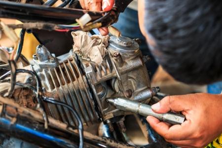 lubricator: Motorcycle mechanic,Technician  Stock Photo