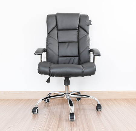 arms chair: Office chair on laminate flooring  Stock Photo