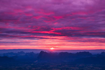 Beautiful winter sunrise in mountains and first light morning sunrise in nature  photo