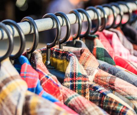 garb: Fashion clothing on hangers