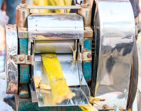 Extracting sugar cane juice sell  photo