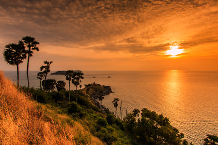 Sunset view Promthep Cape is a mountain of rock at Phuket province asia Thailand  photo