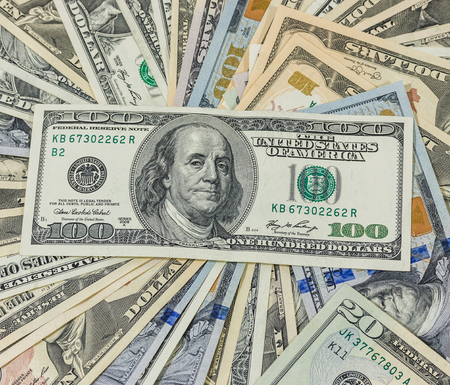 one hundred dollars: dollars pile as background Stock Photo
